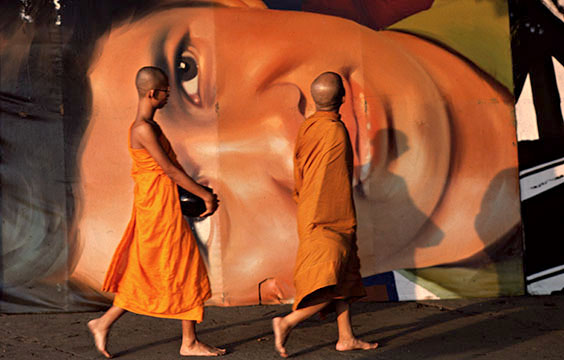 Photo of monks in front of a Richard Gere American Gigolo Poster in Bangkok
