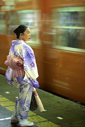 Photo of a woman in Tokyo, Japan wearing a Kimono at Shinjuku train station