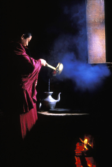Photo of a monk in Muli, China making tea at a monastery