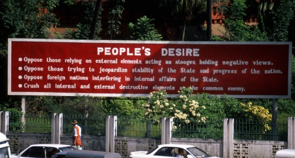 Photo of a government propaganda sign in Rangoon, Burma
