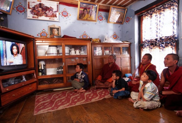 Photo of monks watching television