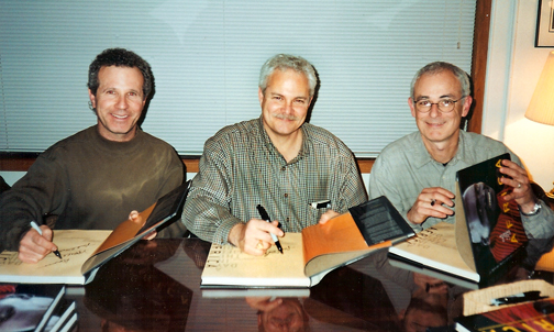 Photo of photographers Jeffrey Aaronson, Larry Price and Michael Lewis at a book signing for A Day in the Life of Africa
