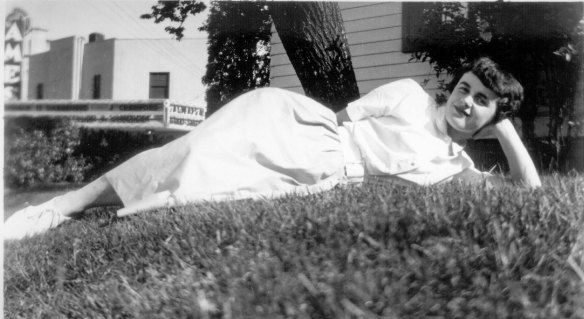 Photo of mom laying on the grass