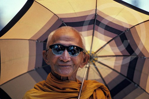 Photo of a monk wearing Ray Bans
