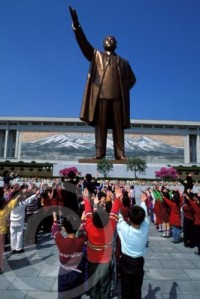 Photo of children saluting Kim Il Sung Statue in Pyongyang, North Korea