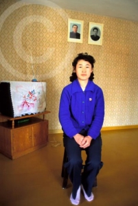 Photo of a typical North Korean home with portraits of Kim il Sung and Kim Jong Il