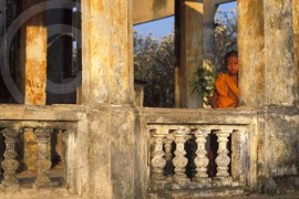 Photo of a young monk at Angkor Wat in Cambodia