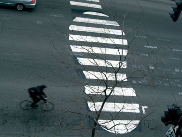 Photo of street art shoe crosswalk