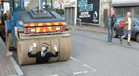 Photo of street art steam roller