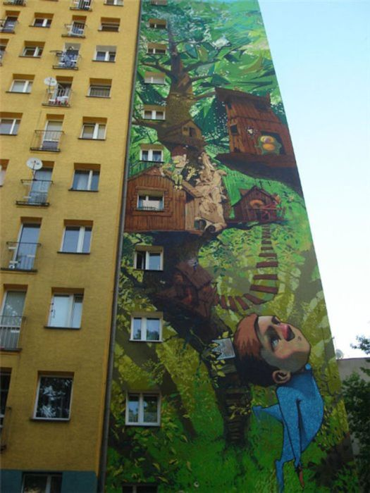 Photo of street art treehouse building