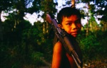 Photo of boy with AK-47 in Cambodia