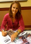 Becky Green Aaronson doing a book signing for the Ultimate Runner