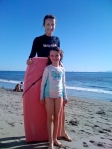 Becky Green Aaronson boogie boarding with her daughter