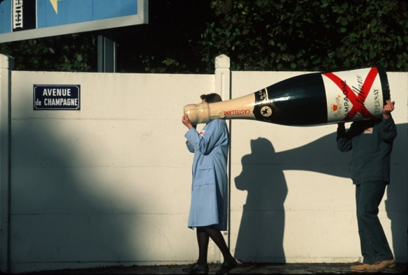 Photo of a giant champagne bottle being carried in Champagne, France