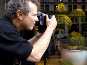 Photo of Jeffrey Aaronson taking pictures